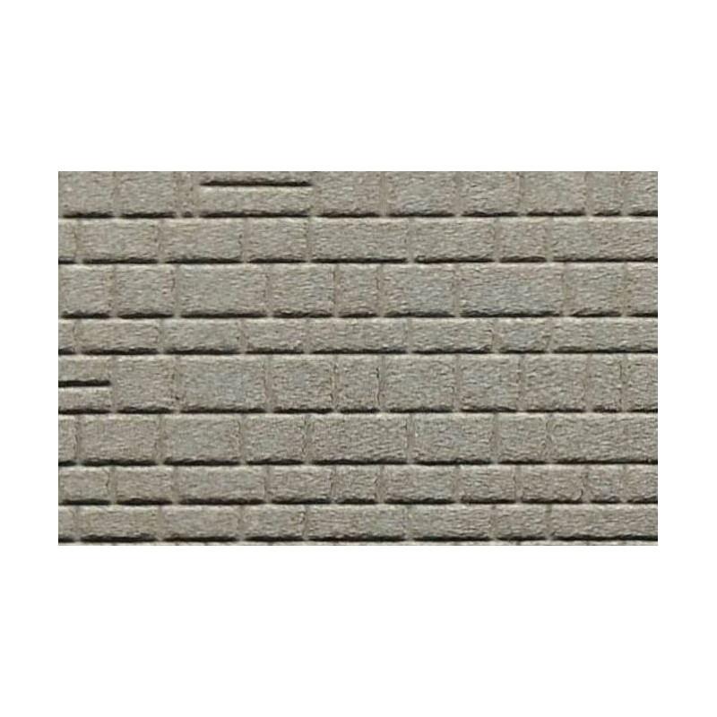 Pavés irréguliers/mur de briques lisses irrégulières