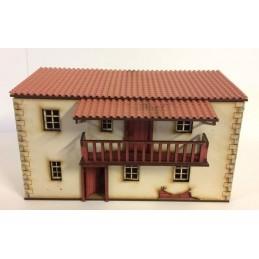 Maison espagnole à deux étages avec balcon