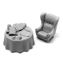 Table encombrée et fauteuil