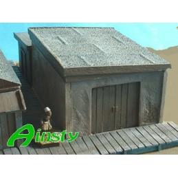 Cabane en torchi avec toit plat