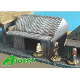 Cabane en tôle avec toit en pente en tôle